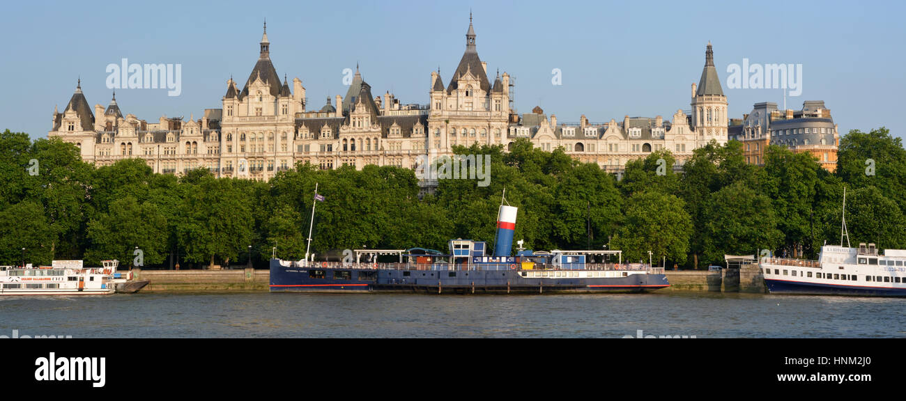 London, United Kingdom - July 17, 2013: Historic buildings on Victoria Embankment. In the foreground party & - Stock Image
