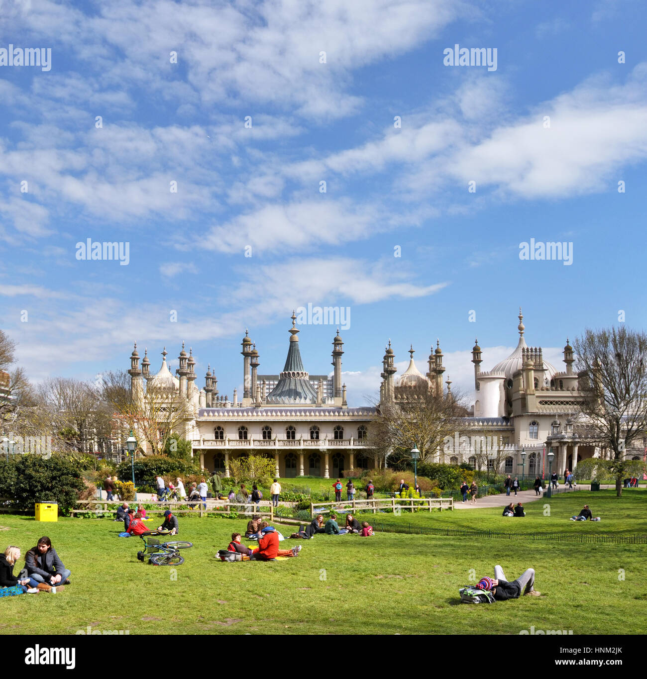 Brighton, United Kingdom - April 16, 2012: Vertical panorama view of tourists pinicing on the grass outside the - Stock Image