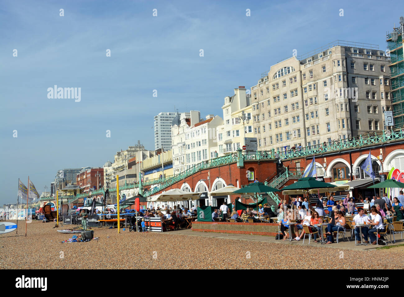 Brighton, United Kingdom - September 28, 2014: A busy lunchtime crowd on a summer day at the restaurants on Brighton - Stock Image