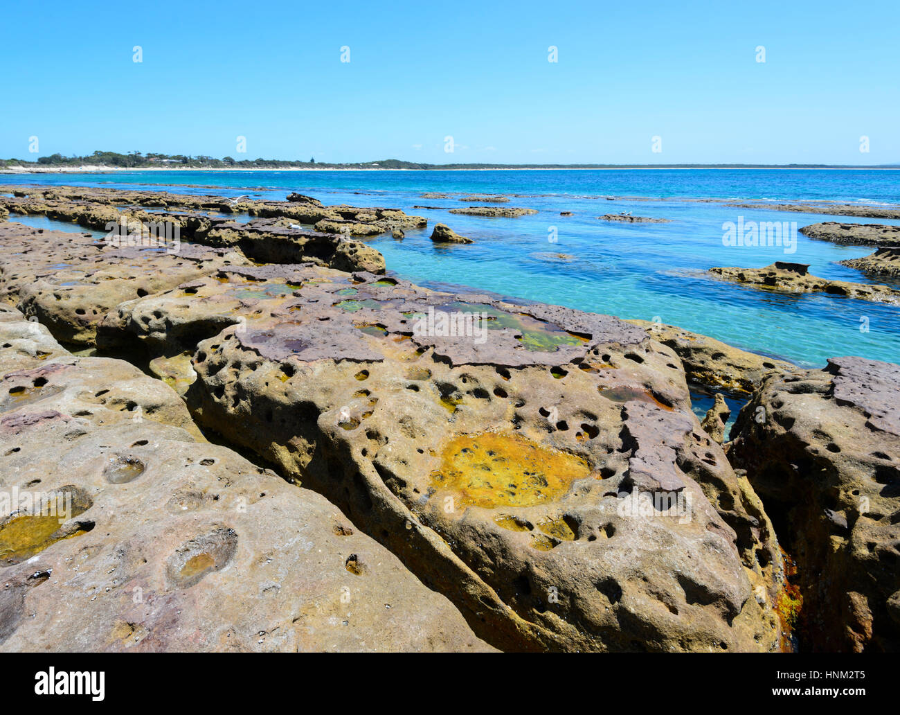 Sandstone rock formations at the scenic beach of Currarong, Shoalhaven area, New South Wales, NSW, Australia - Stock Image