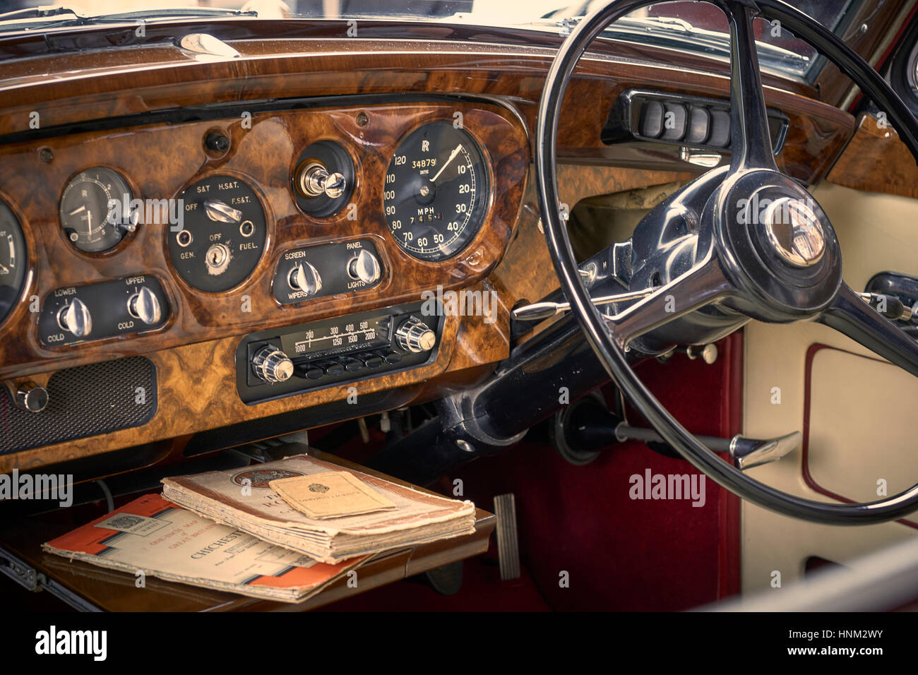 Vintage car dashboard with walnut and chrome - Stock Image