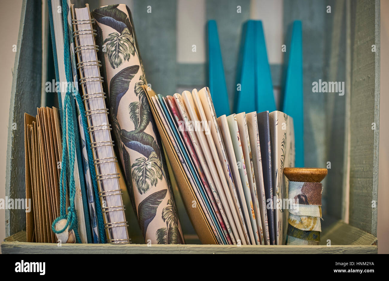 A Collection of designer stationary on a shelf - Stock Image