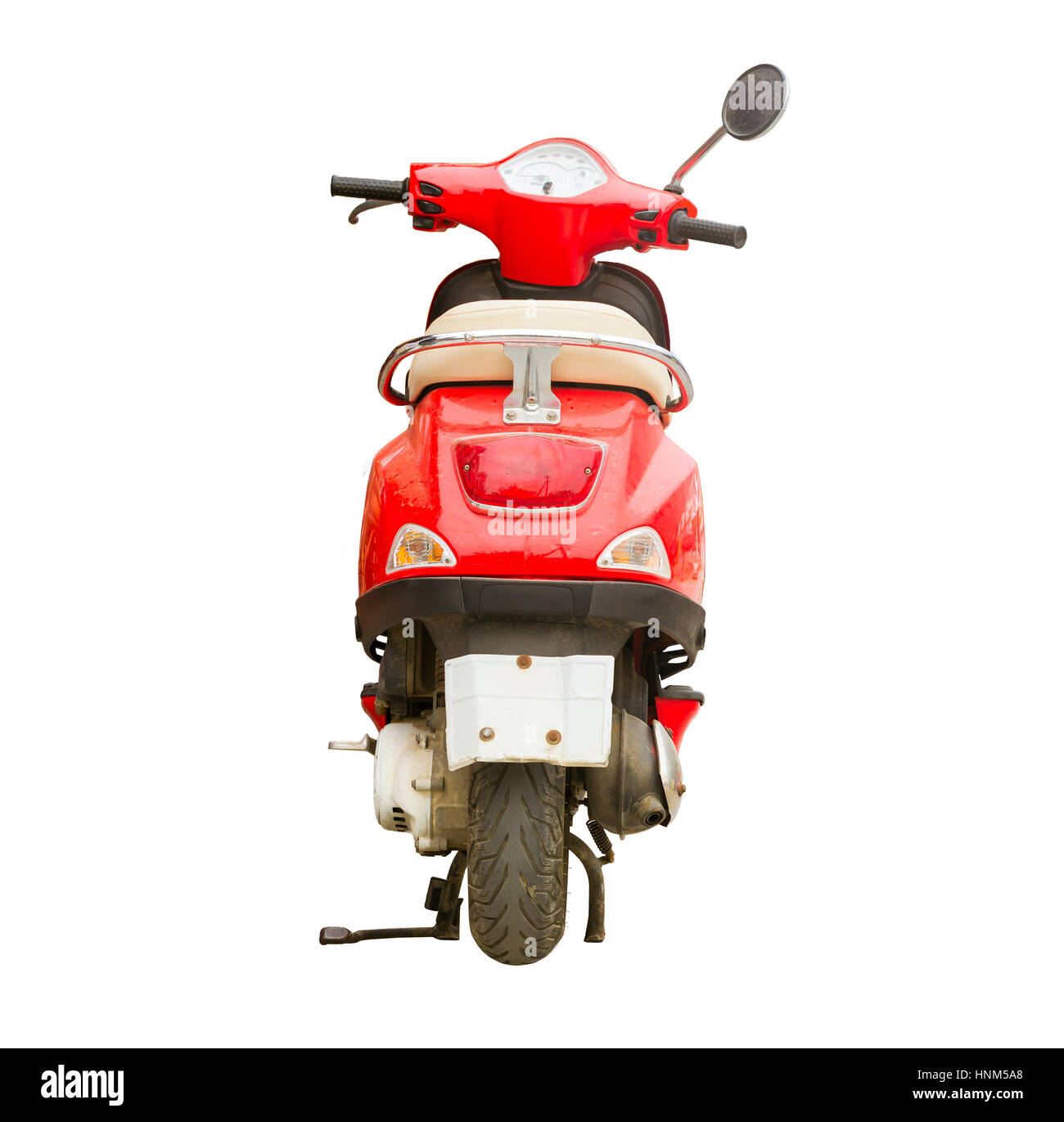 Red scooter isolated on background. Stylish bright hipster two-wheeled moped is the perfect vehicle for the narrow - Stock Image
