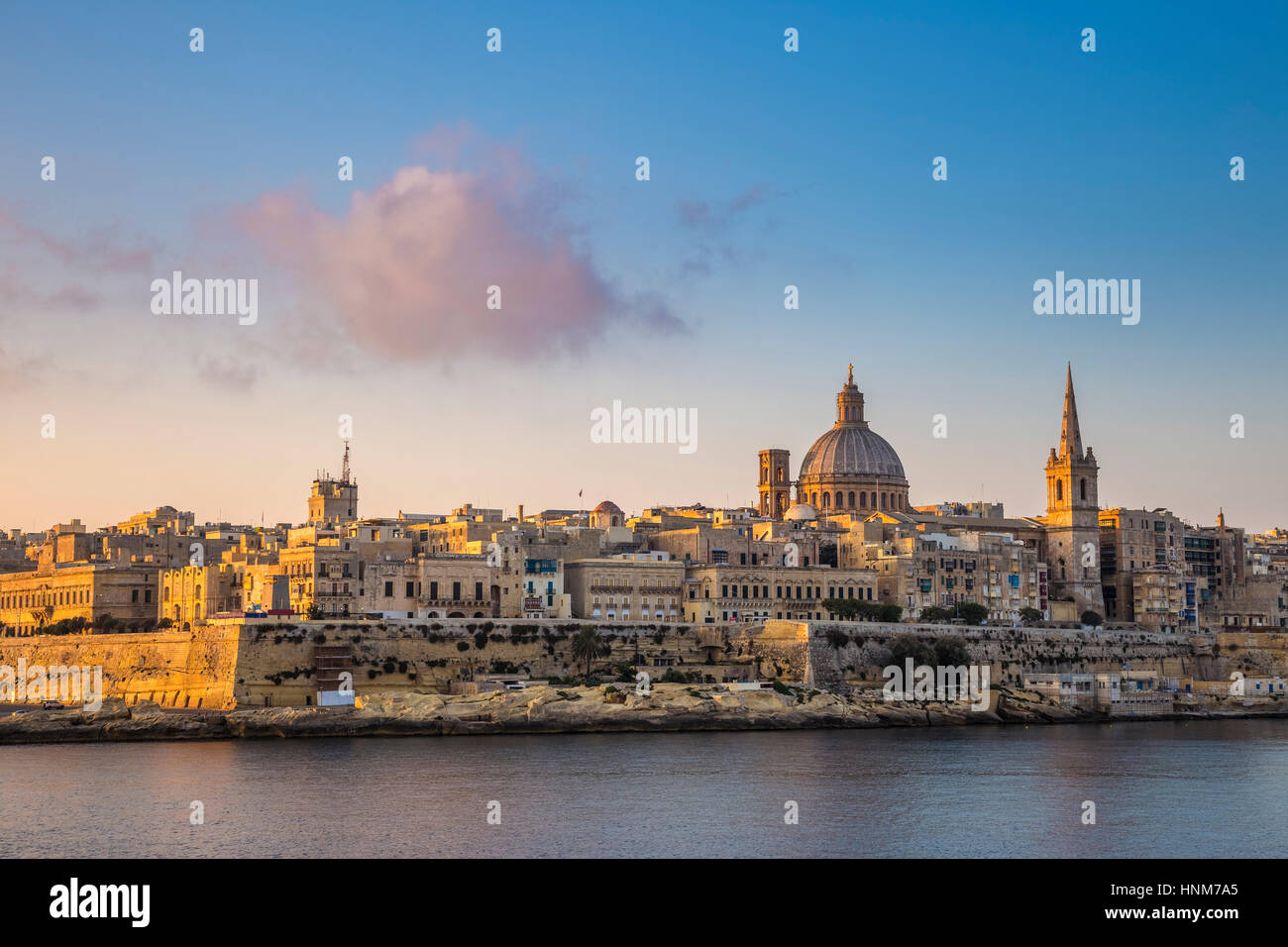 Valletta, Malta - St.Paul's Cathedral and the ancient city of Valletta at sunrise - Stock Image