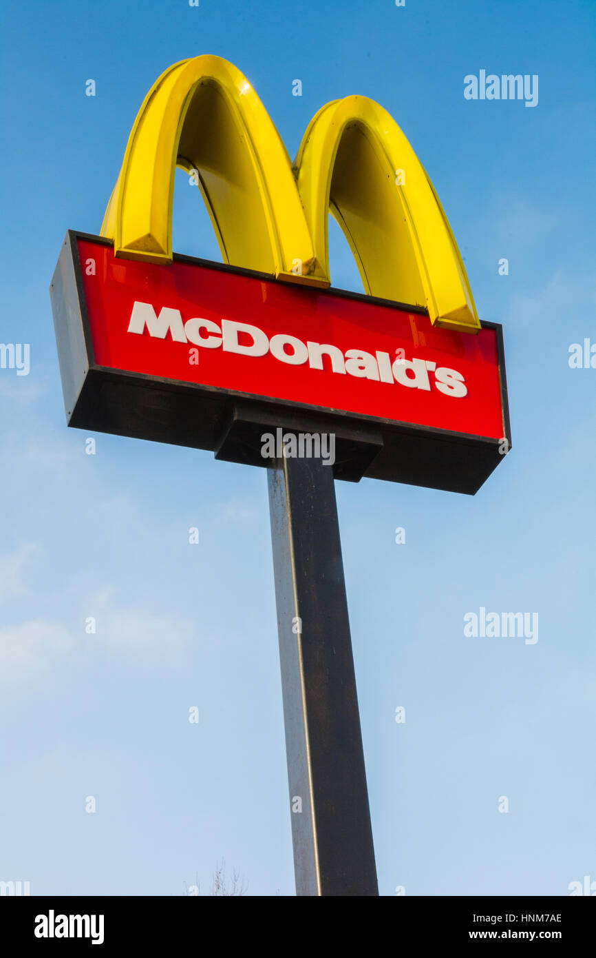McDonald's Logo arches sign against a blue sky outside a branch in Brentford, London, UK - Stock Image