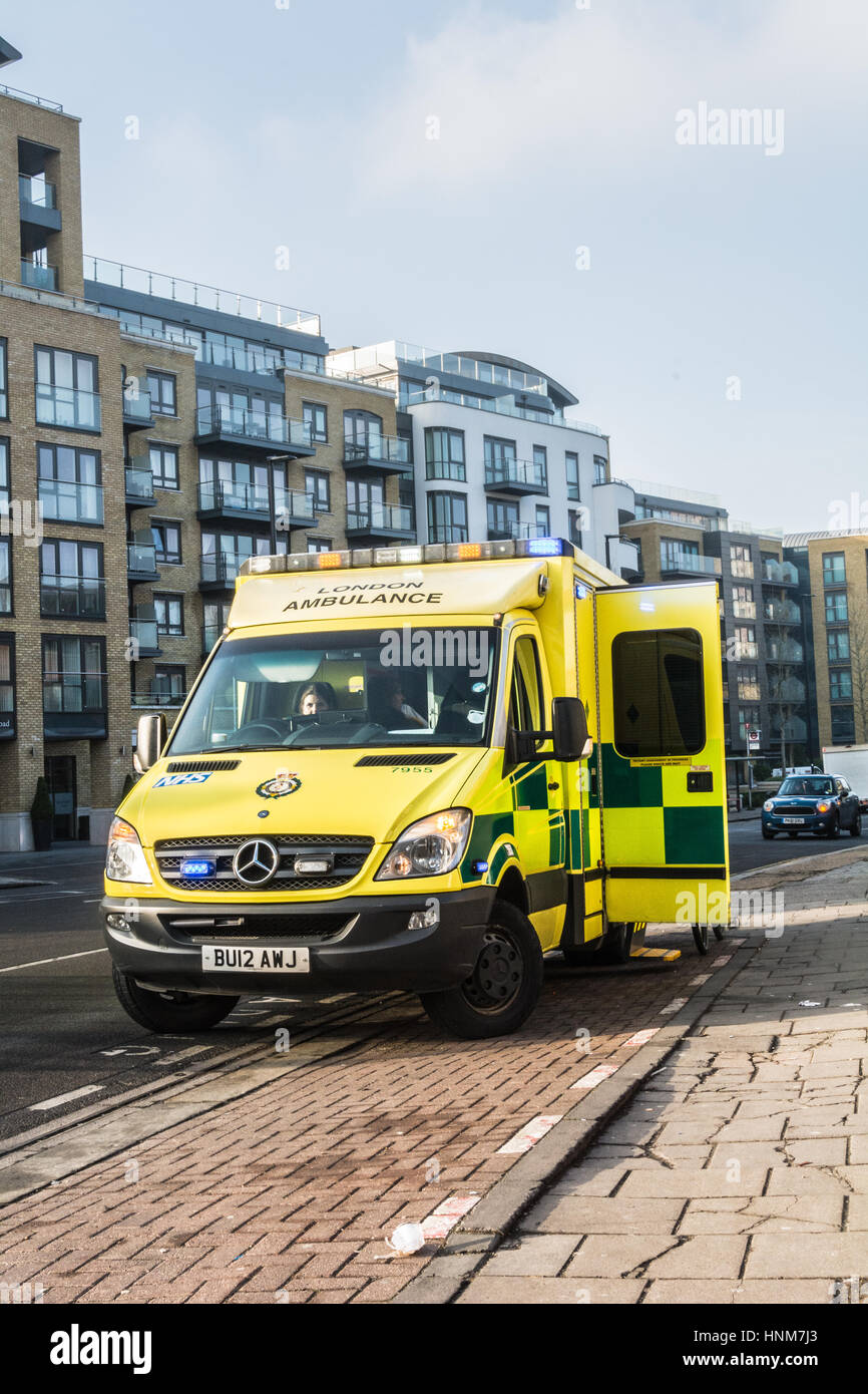 Ambulance attends to injured cyclist - Stock Image