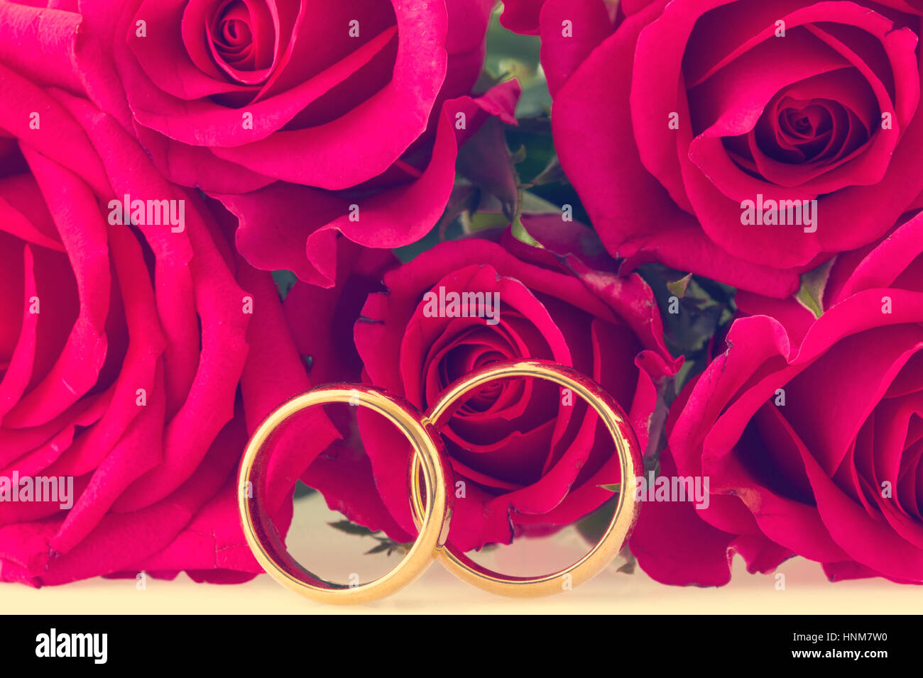 Wedding rings with red roses on background Stock Photo: 133825580 ...
