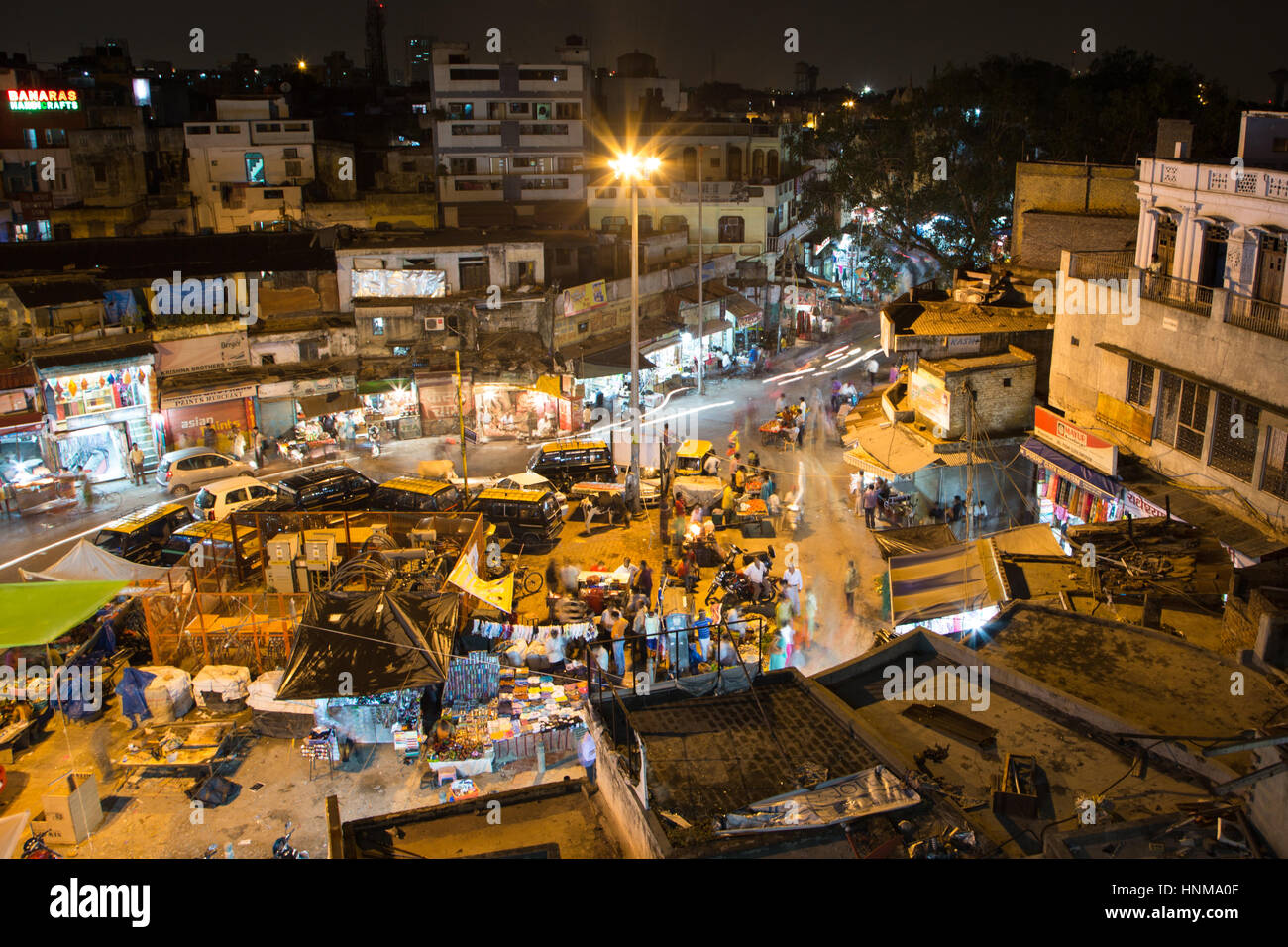 New Delhi, India - September 7 2014: People, captured with blurred motion, walk in the New Delhi bazaar street in - Stock Image
