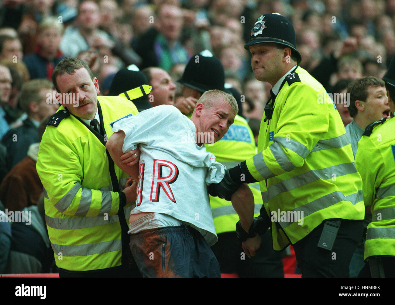 TOTTENHAM FAN GETS REMOVED FRM HIGHBURY 29.4.95. 04 May 1995 - Stock Image