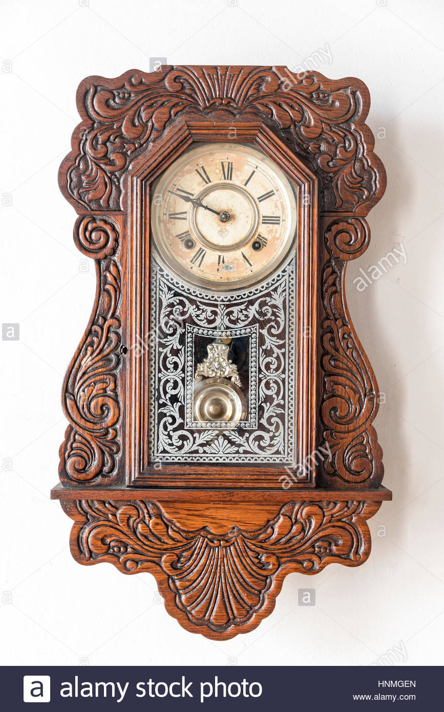 Cuban vintage objects: Old colonial wall clock. The items are preserved in 'La Periquera' building which is a tourist Stock Photo
