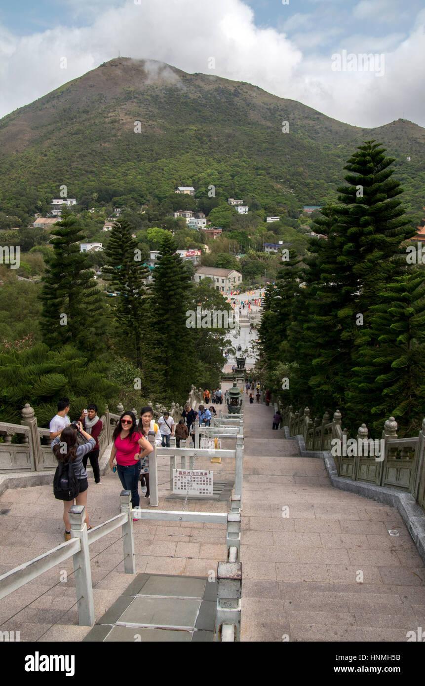 Tourists at the Po Lin Monastery at Lantau Island in Hong Kong. - Stock Image
