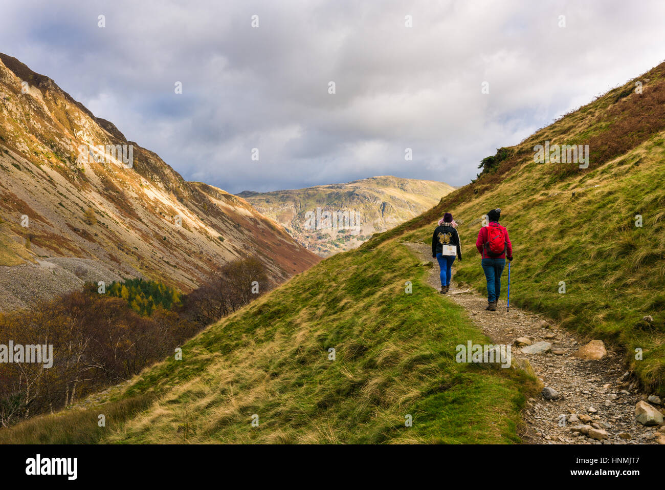 Fell walking in the Glenridding valley with Glenridding Screes on the left and Place Fell ahead. Lake District National - Stock Image