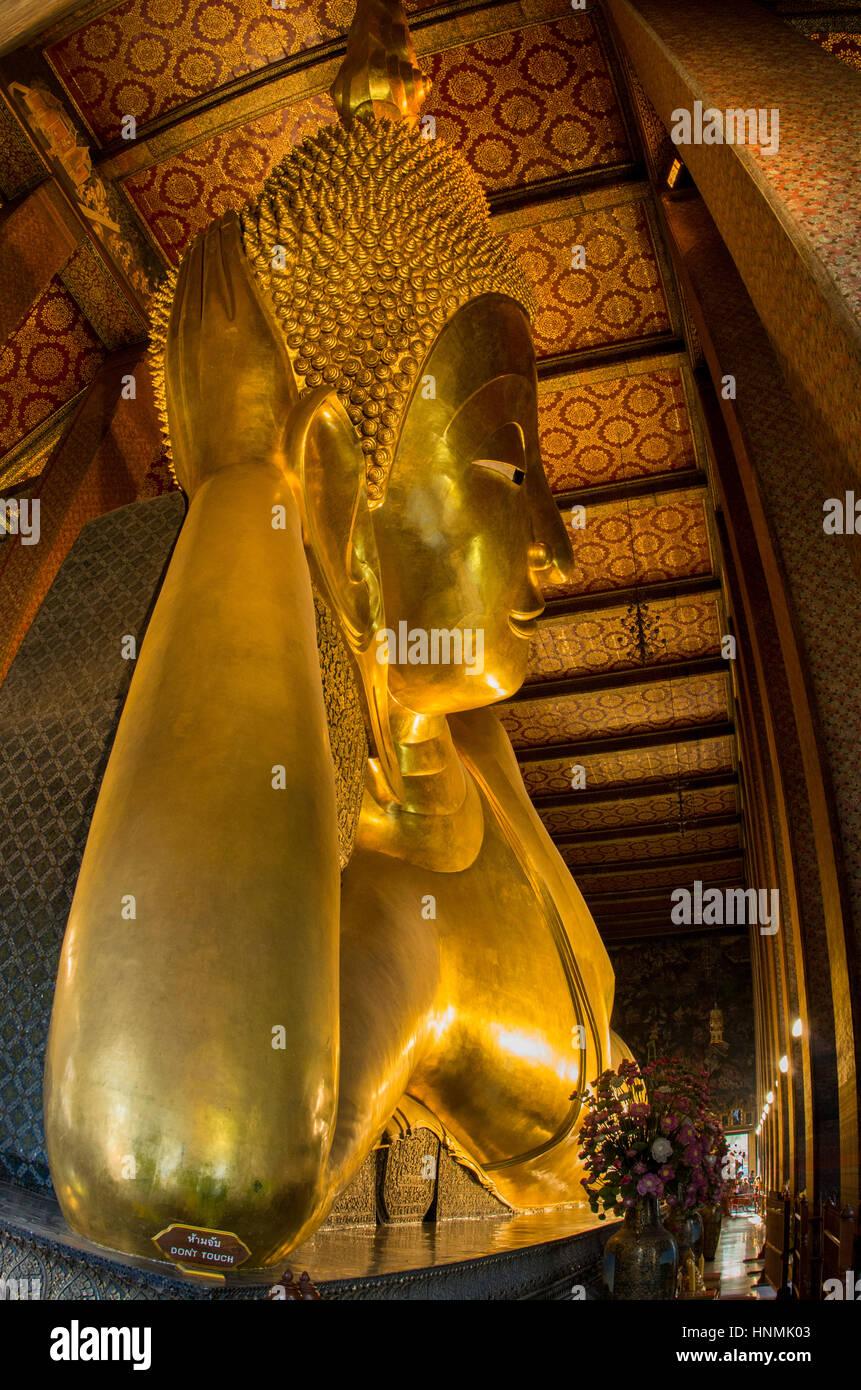 The large reclining Buddha statue at Wat Pho in Bangkok, Thailand. - Stock Image