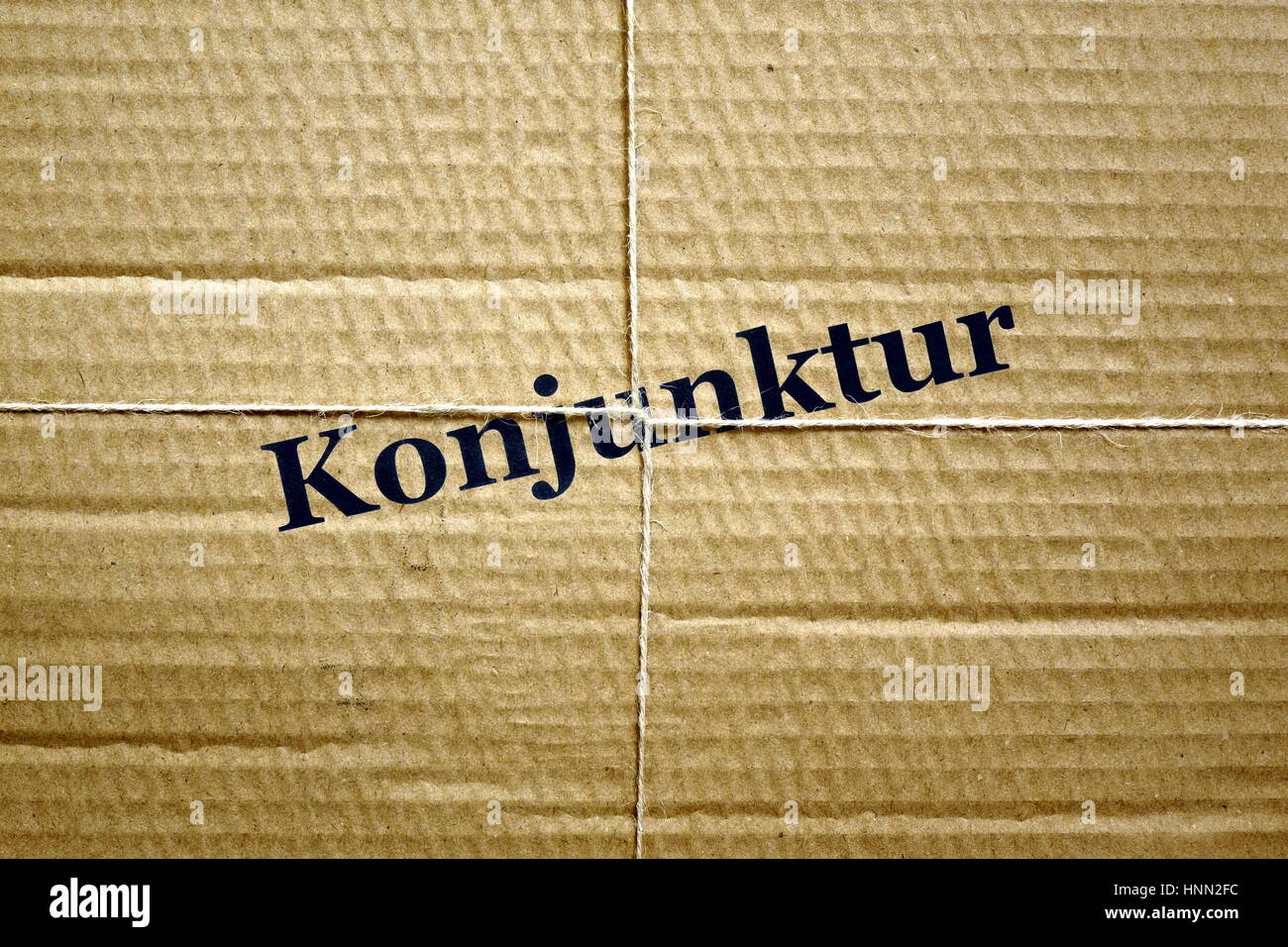 Berlin, Germany. 30th May, 2016. ILLUSTRATION - Image of a bound up package with the word 'Konjunktur' (economic - Stock Image