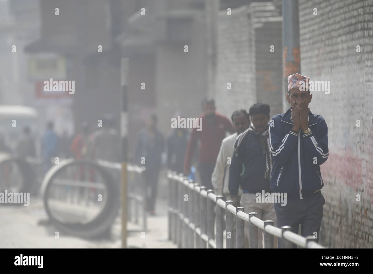 Kathmandu, Nepal. 15th Feb, 2017. A Nepalese man covers his nose to ...