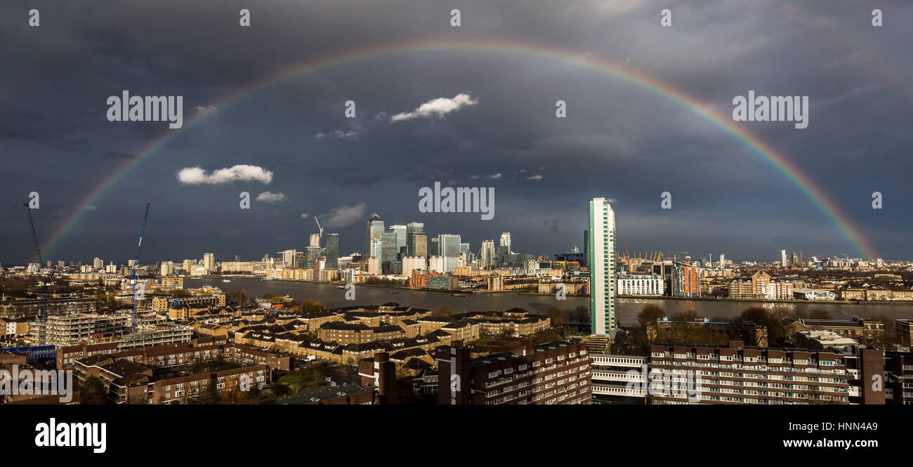 London, UK. 15th Feb, 2017. UK Weather: Massive colourful rainbow breaks over south east London including Canary Stock Photo