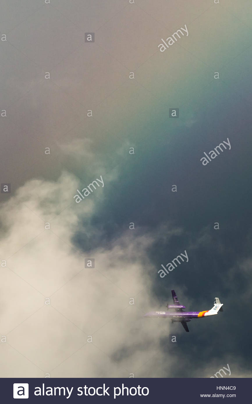 London, UK. 15th Feb, 2017. UK Weather: A Flybe Bombardier Dash-8 plane leaving City Airport approaches a massive - Stock Image