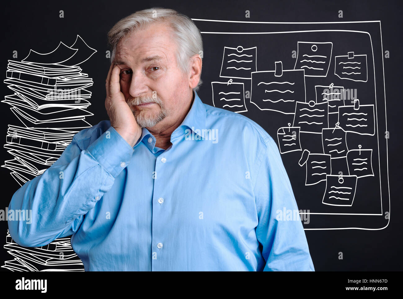 Unhappy stressful man having a heavy workload - Stock Image