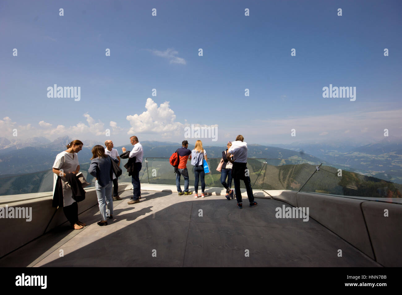 People looking at the dolomites from the terrace of the Messner Corones Mountain Museum in the Italian Alps designed - Stock Image