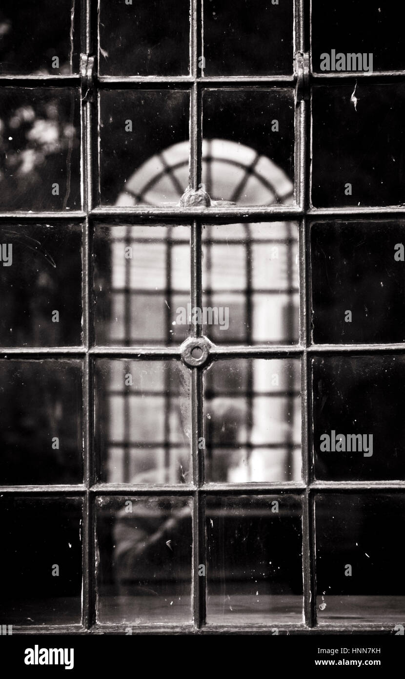 Black and white infrared photograph of old metalled framed windows at Avoncroft Museum which is home to over 30 - Stock Image