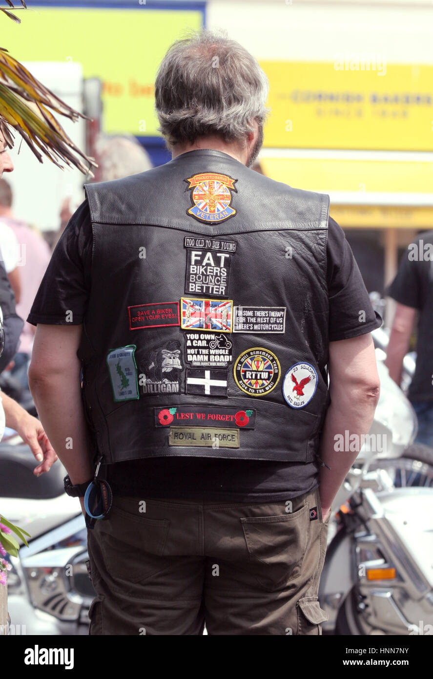 MOTORCYCLIST with his leader vest and brands 2015 at a biker gathering in Truro Cornwall - Stock Image