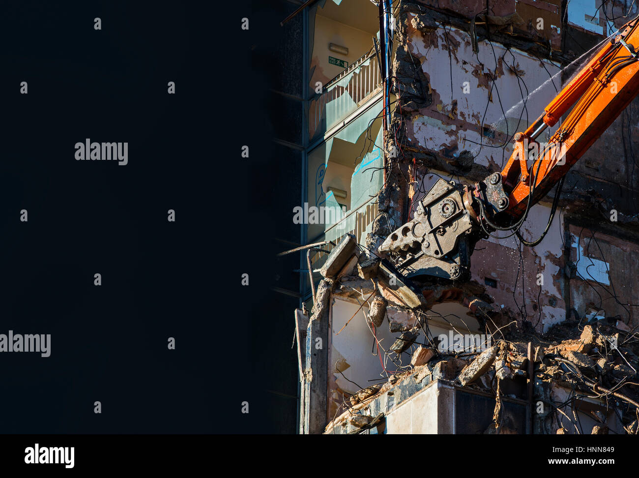 Demolition with High Reach Excavator at work - Stock Image