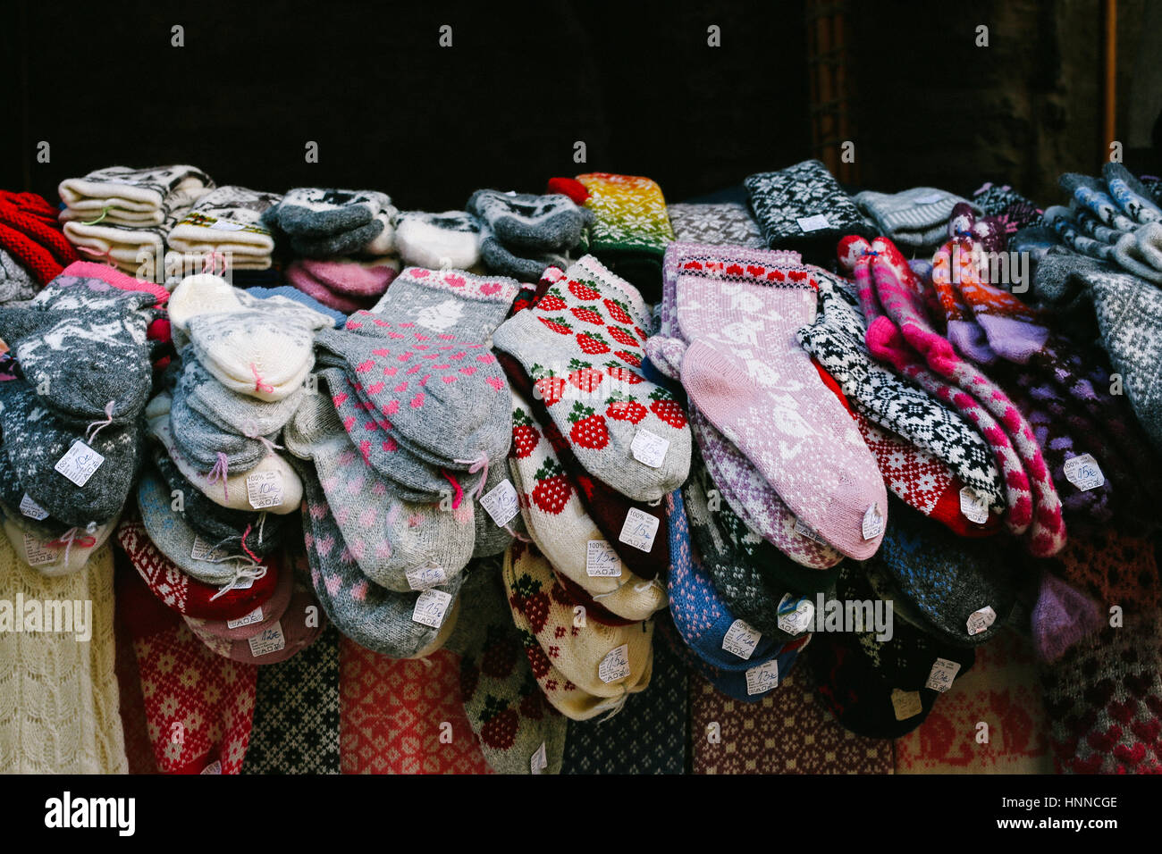 Selection of colourful traditional woolen socks with different patterns on a market stall in Old Town of Tallinn, - Stock Image