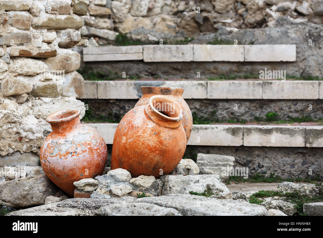 Antique ceramic pots. Old clay vases outdoors. Archaeological still ...