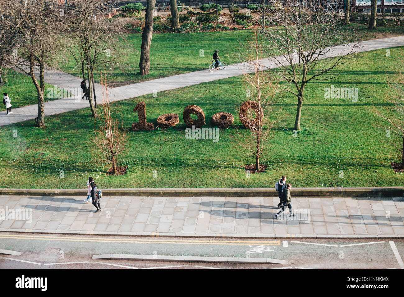 Manchester Oxford Road. University Campus with 10000 Actions sign created by Cherry Chung for the environmental - Stock Image