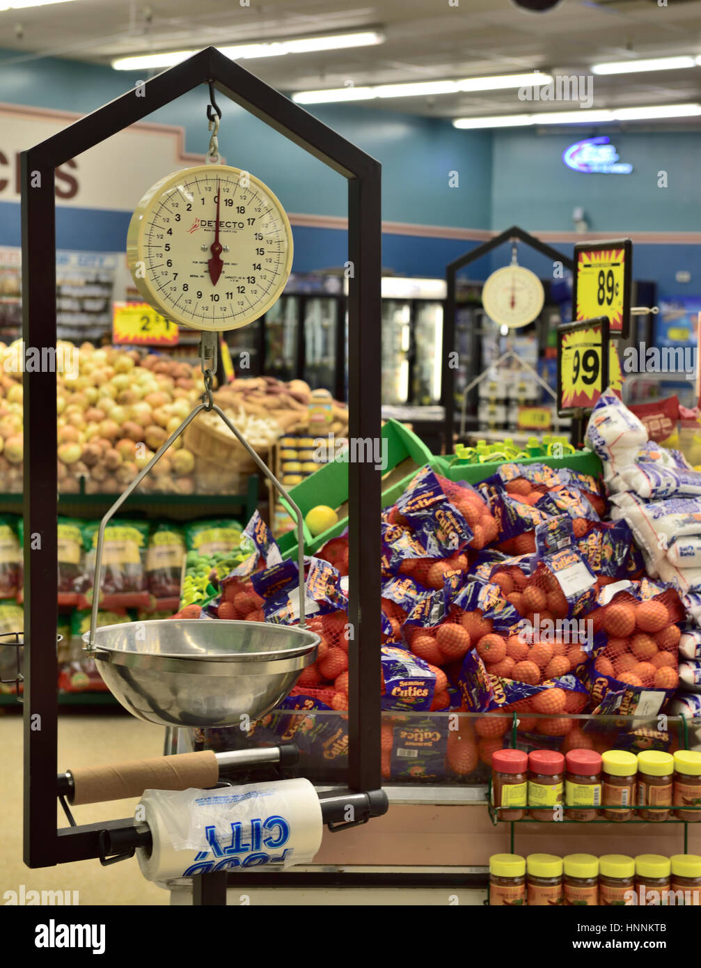 Weighing scales handing with roll of plastic bags in produce section Arizona supermarket, USA - Stock Image