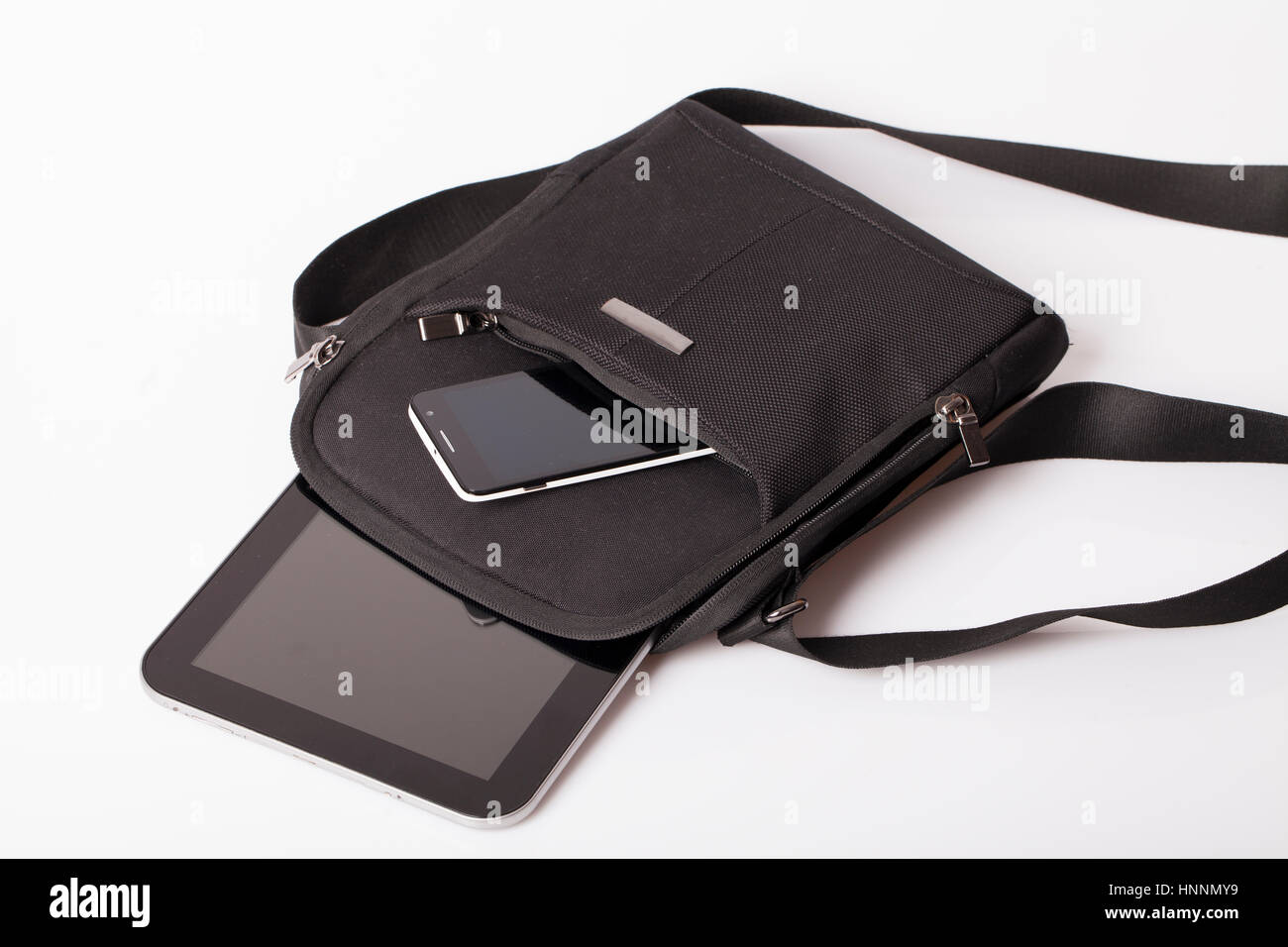 Mens business bag with the tablet and mobile phone - Stock Image