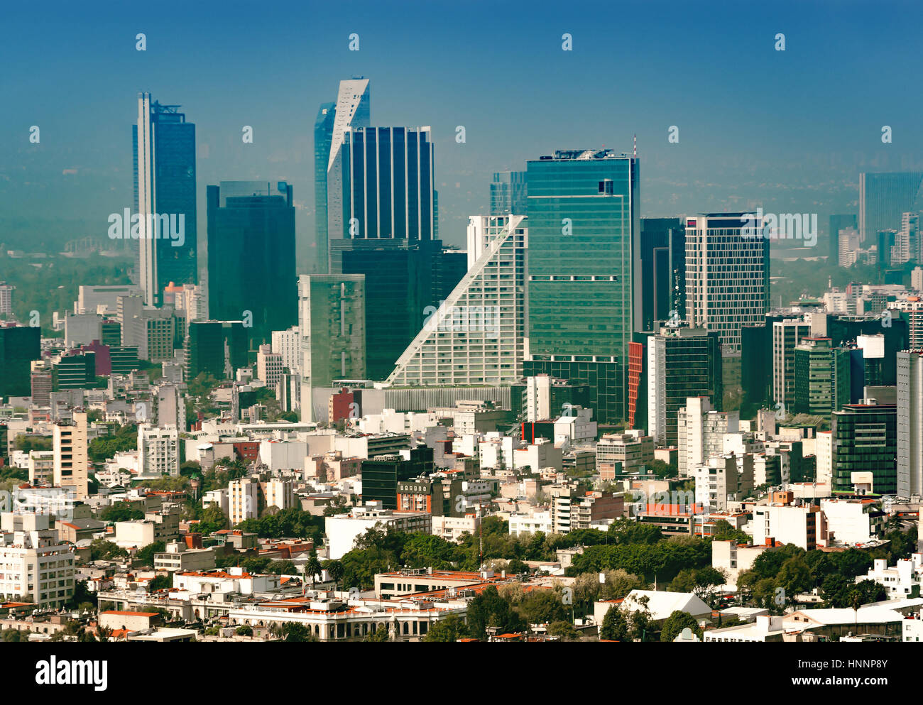 Aerial view of a neighborhood called Colonia Juarez in Mexico City, Mexico, on a sunny morning with some haze. - Stock Image