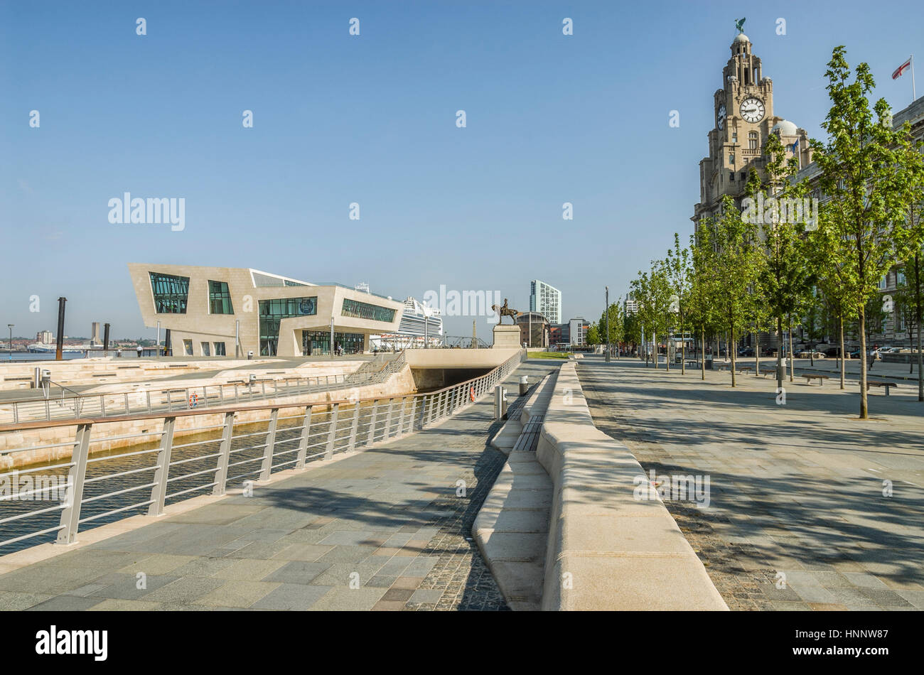 """The new ferry terminal at Pier Head in Liverpool sits in front of the """"Three Graces"""" on a UNESCO World Heritage - Stock Image"""