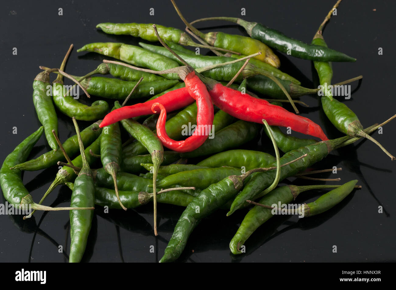 green chili peppers and red - Stock Image
