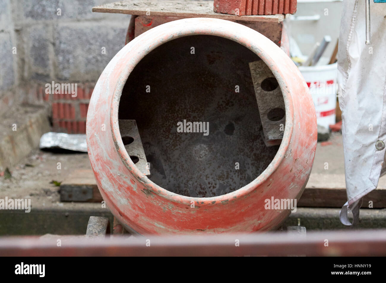 old used cement mixer on an extension household construction site in the uk - Stock Image
