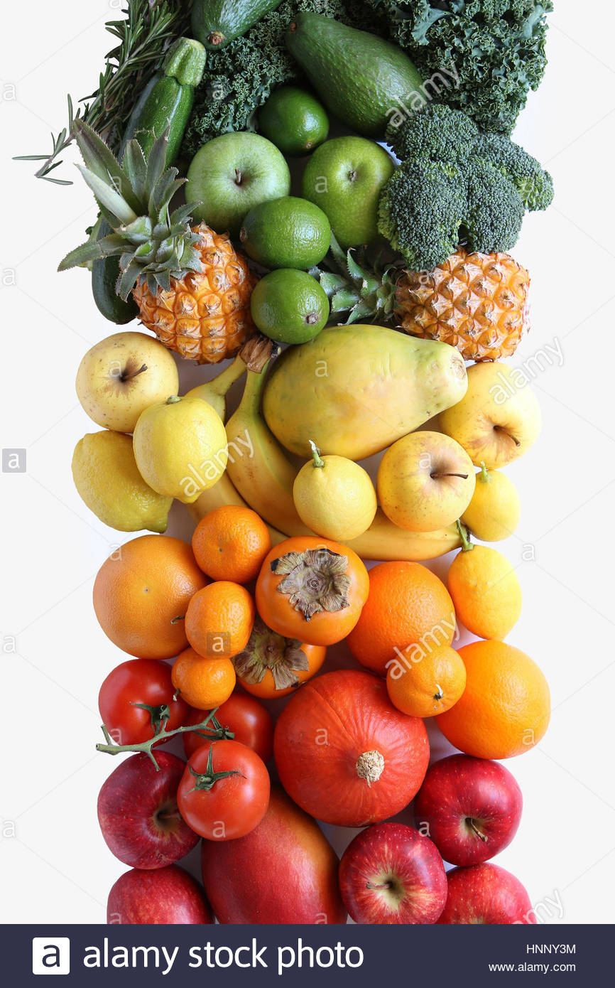 Gradient fruit and vegetables on white background.Top view - Stock Image