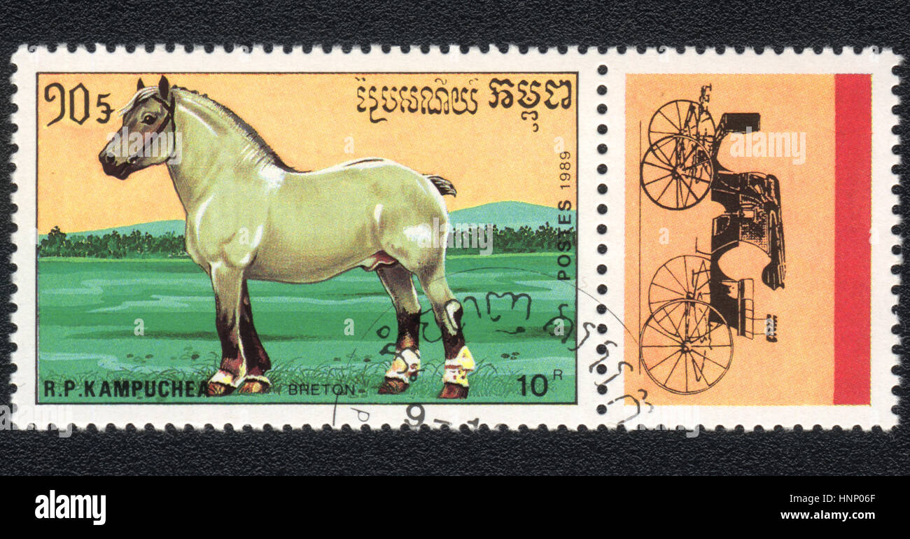A postage stamp printed in R.P. Kampuchea  shows  a Breton, draught horse and coach  1989 - Stock Image