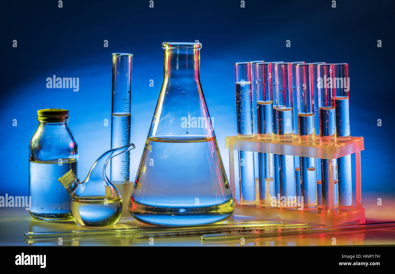 Different laboratory beakers and glassware. Multicolored. Stock Photo