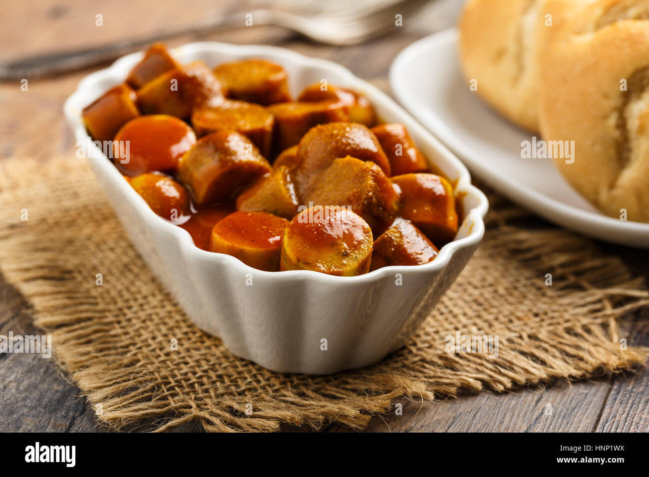 german currywurst - pieces of curried sausage - Stock Image
