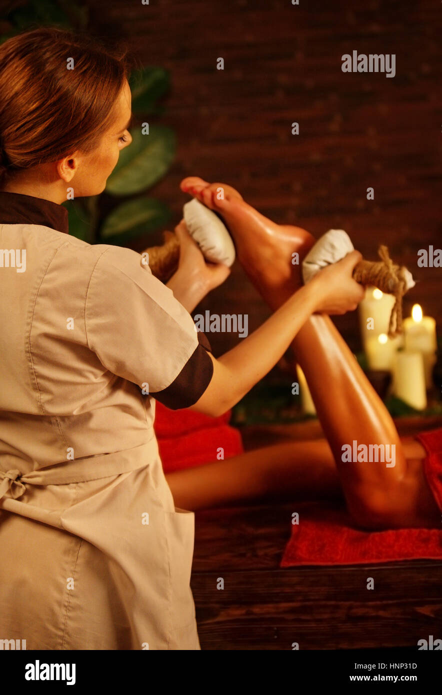 Feet massage with Thai reflexology. Cropped shot of foot reflexology. Stock Photo