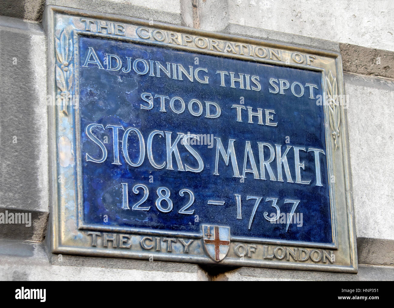 Corporation of London blue plaque for the London stock stocks market site from 1282 - 1737 on a building in the - Stock Image