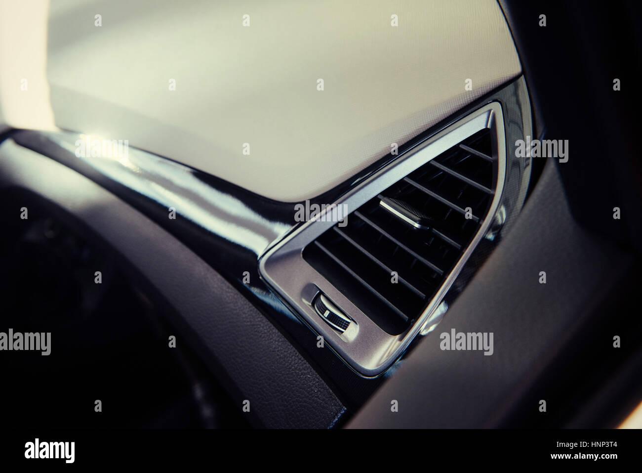 Modern car interior dashboard and steering wheel. - Stock Image
