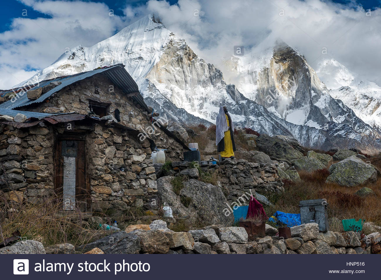 A sadhu resides in a stone ashram at 14,200 feet in the Garhwal range of the Indian Himalaya. - Stock Image