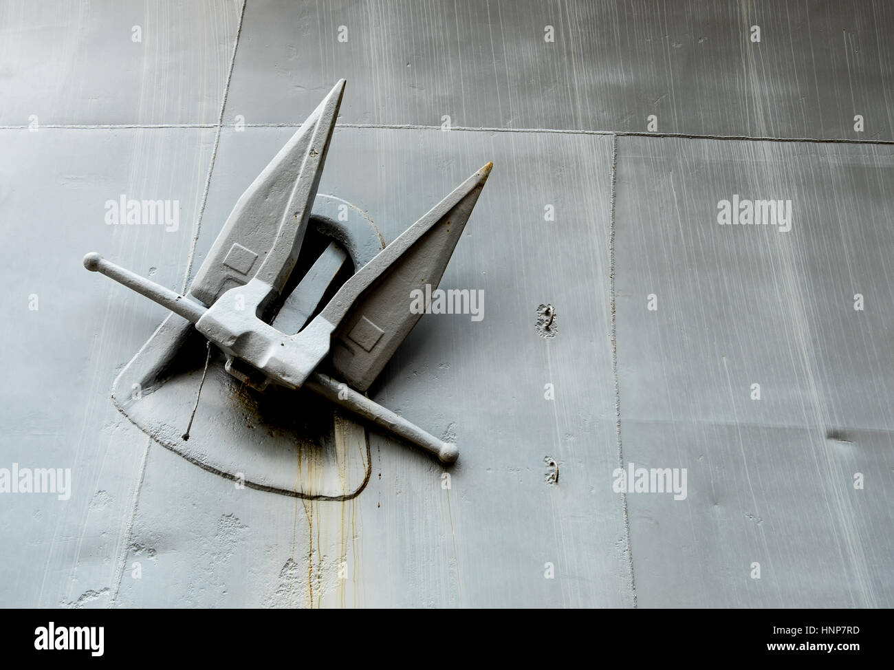 A white rusty anchor from battleship. - Stock Image