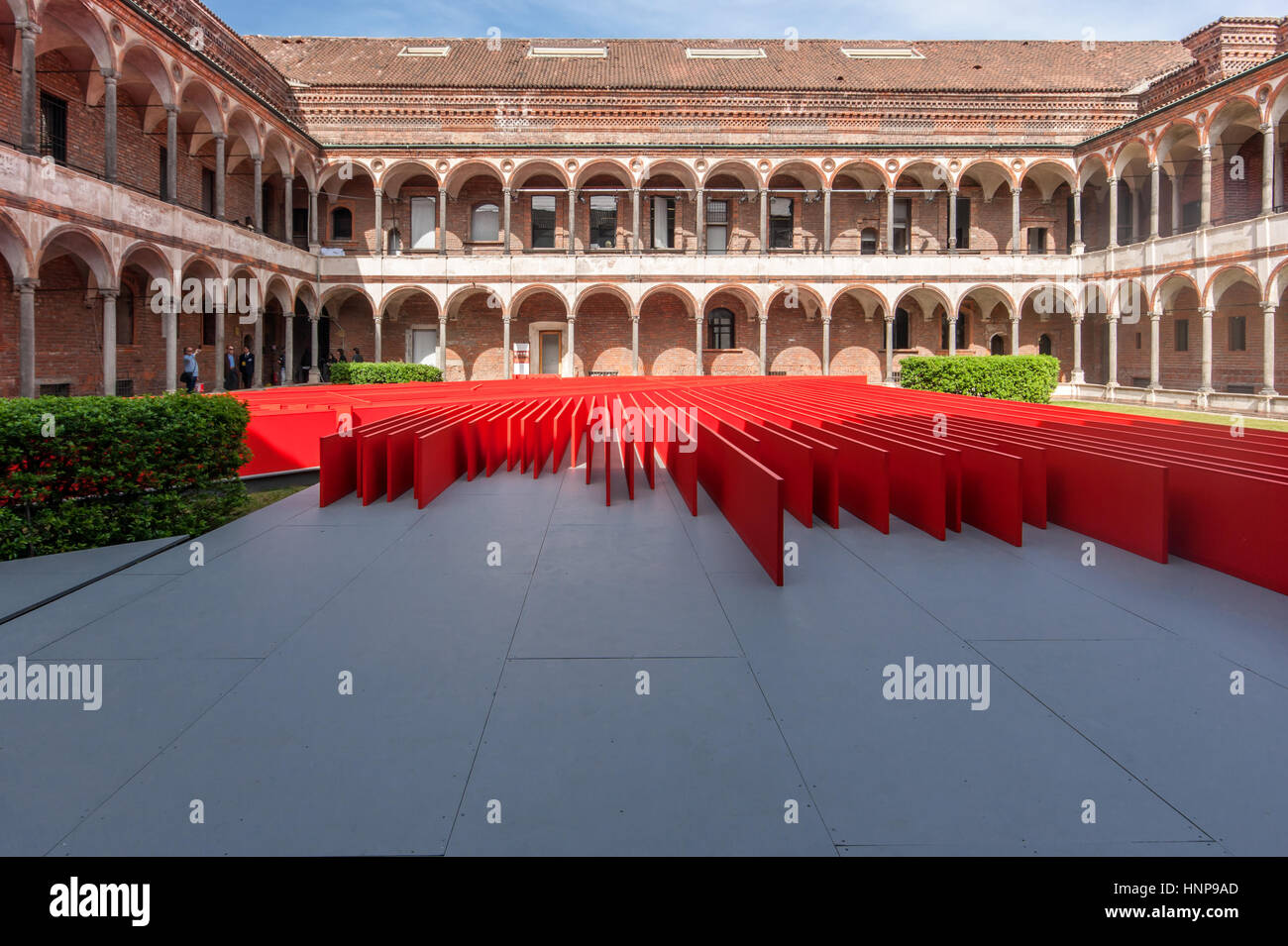 View of the installation 'Red Flowers, designed by Daniel Libeskind for Oikos in the courtyard of the University - Stock Image