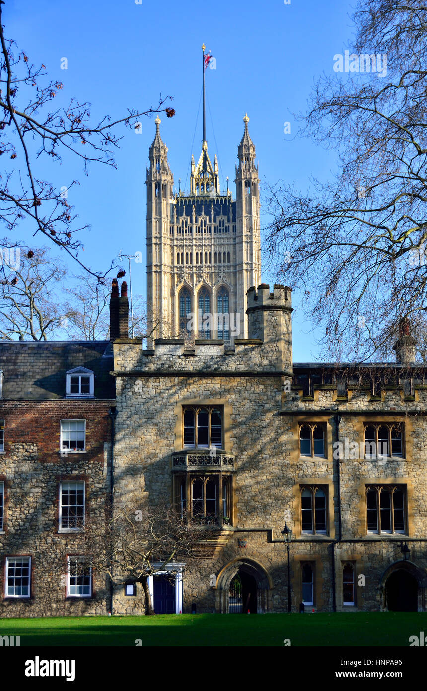 London, England, UK. Houses of Parliament (Victoria Tower) and Westminster School seen from Deans Yard - Stock Image