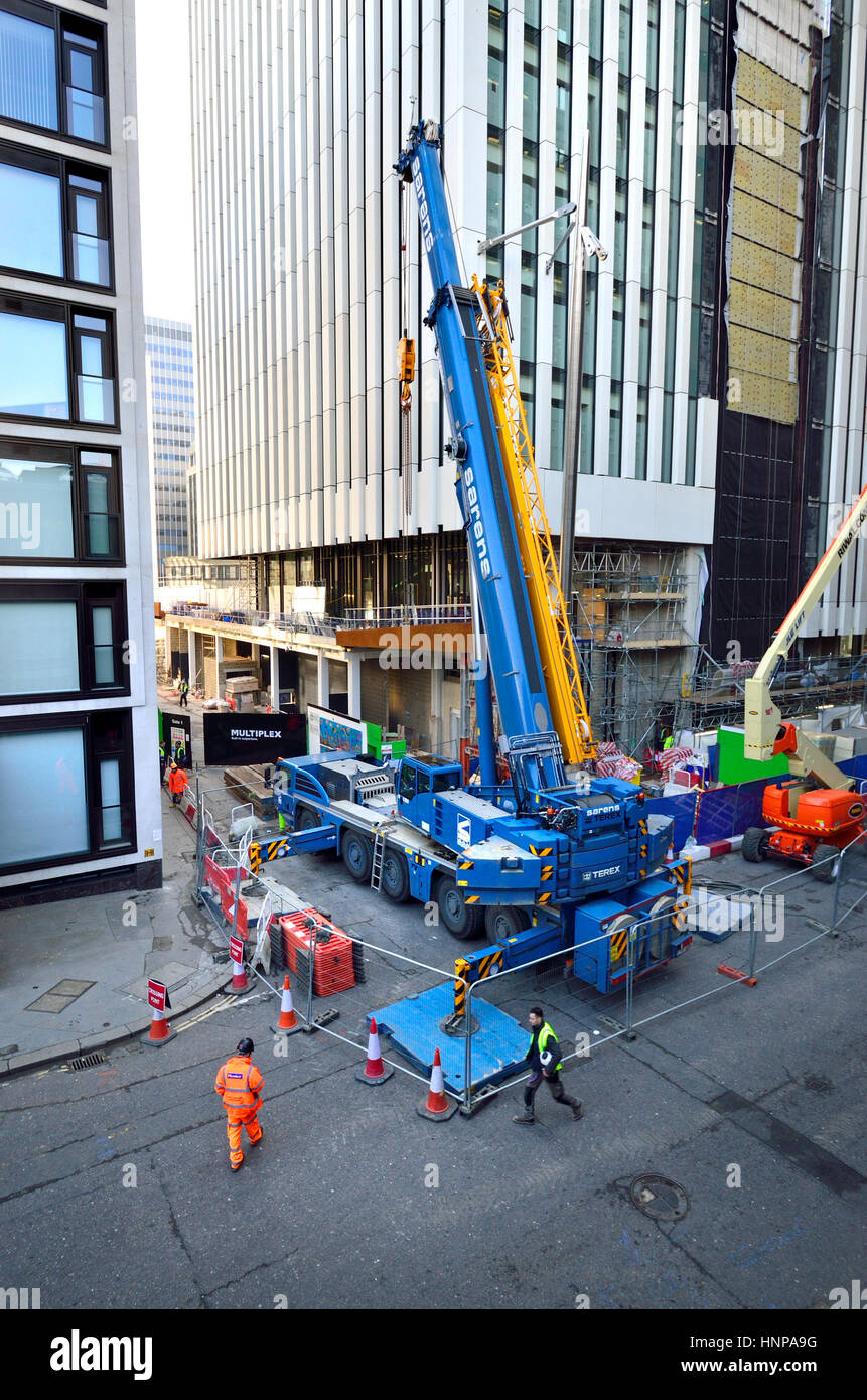 London, England, UK. Sarens Terex AC 100/4L Telescopic crane on a construction site by the Barbican, City of London - Stock Image