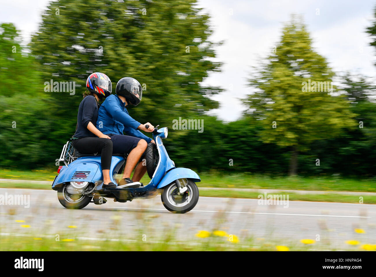 Couple vespa stock photos couple vespa stock images alamy for Coliseum motors north charleston