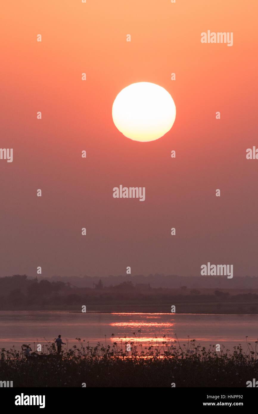 India sunset over Tadoba Lake, Maharashtra State, India Asia - Stock Image