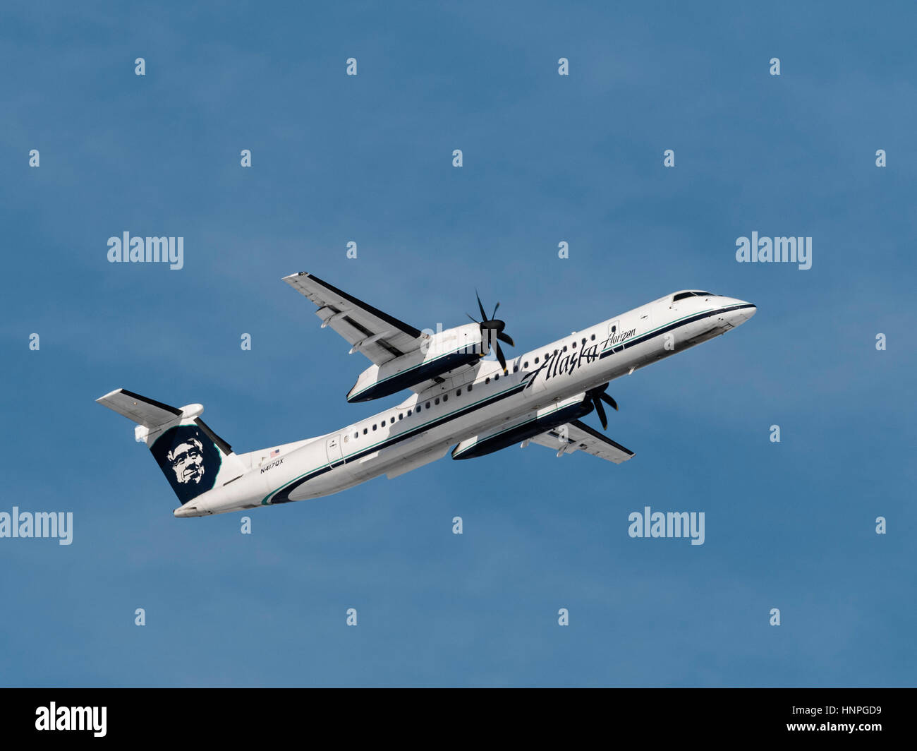 Alaska Airlines (Horizon Air) plane airplane Bombardier Dash 8 Q400 turboprop regional airliner airborne take taking - Stock Image